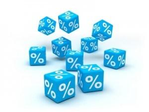 Na grafice widoczne kostki z procentami.